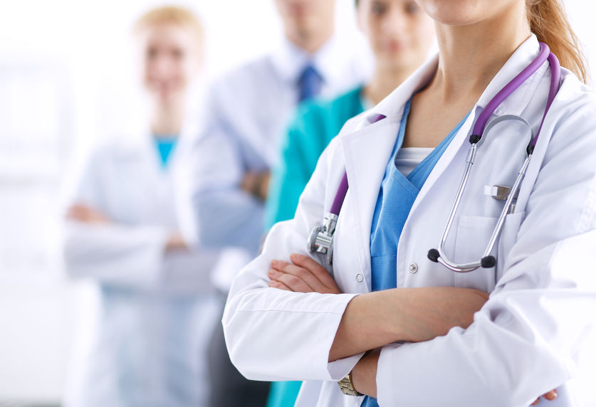 42234811 - attractive female doctor in front of medical group .